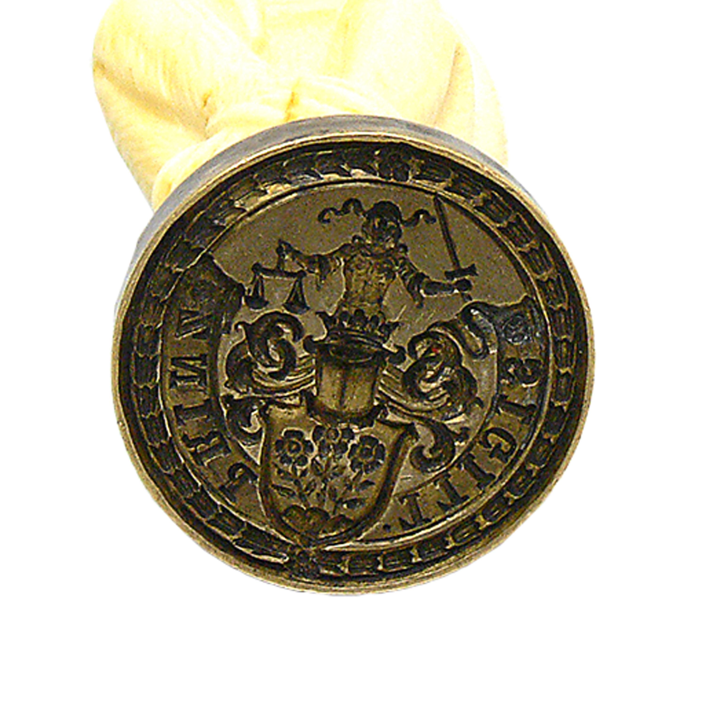 Tłok pieczętny z herbem niemieckiego rodu Esbach